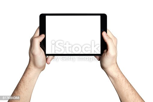 863476202istockphoto Holding tablet with blank screen 517684088