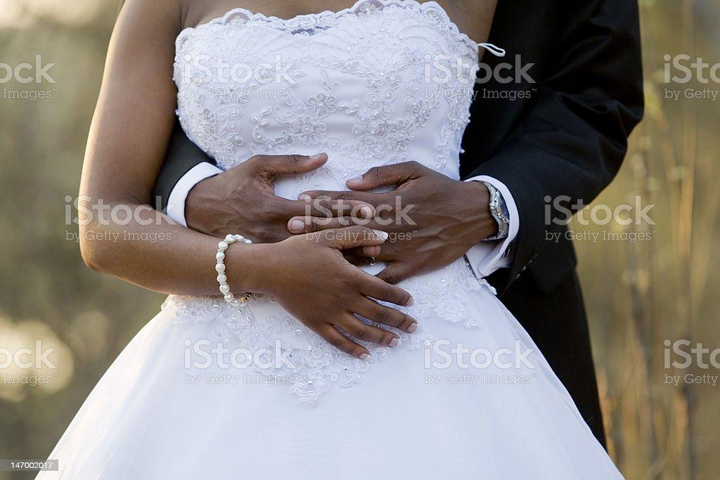 Holding the bride stock photo