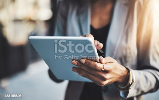Closeup shot of a businesswoman using a digital tablet in the city
