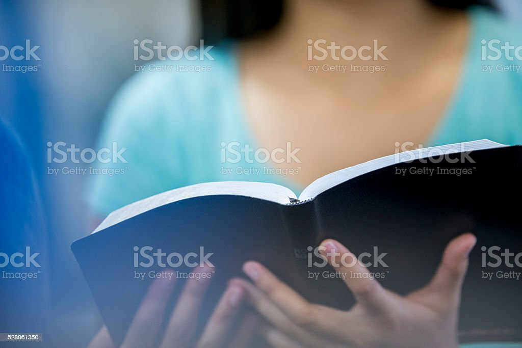 Holding the Holy Bible stock photo