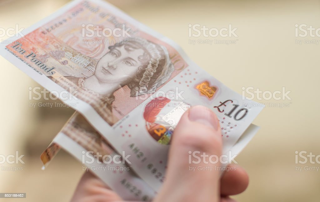 Holding the new for 2017 £10 note UK Currency stock photo
