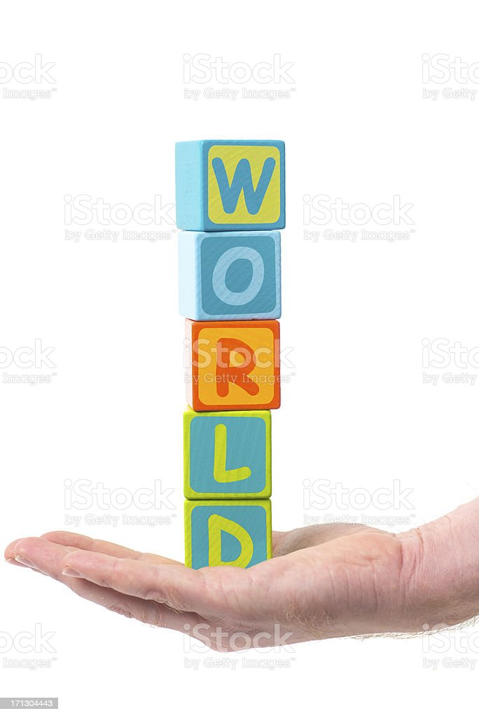 Holding the world in hand as tower stock photo