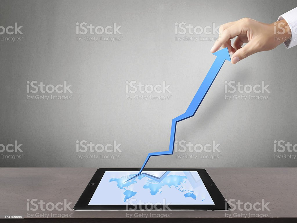 Holding Touch Screen Tablet And With Graph Stock Photo