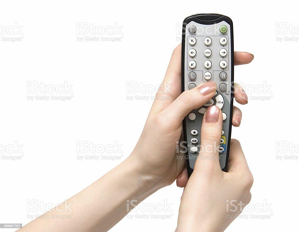 Retención televisor con control remoto foto de stock libre de derechos