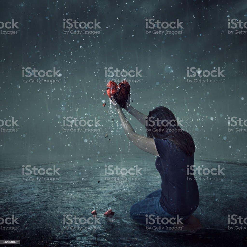Holding up heart stock photo