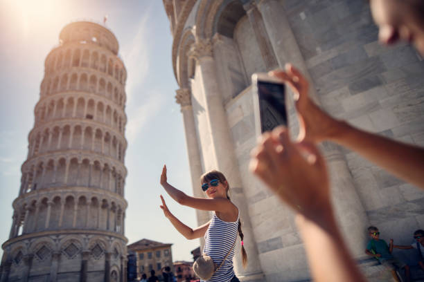 holding up photos of the leaning tower of pisa - europe travel stock photos and pictures