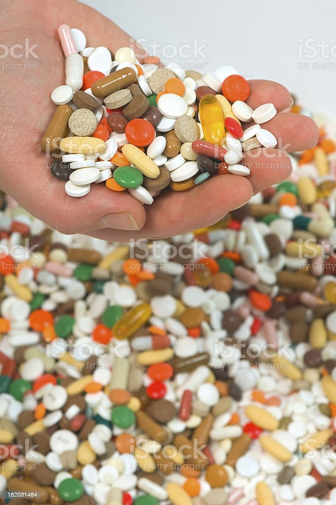 holding up pills stock photo