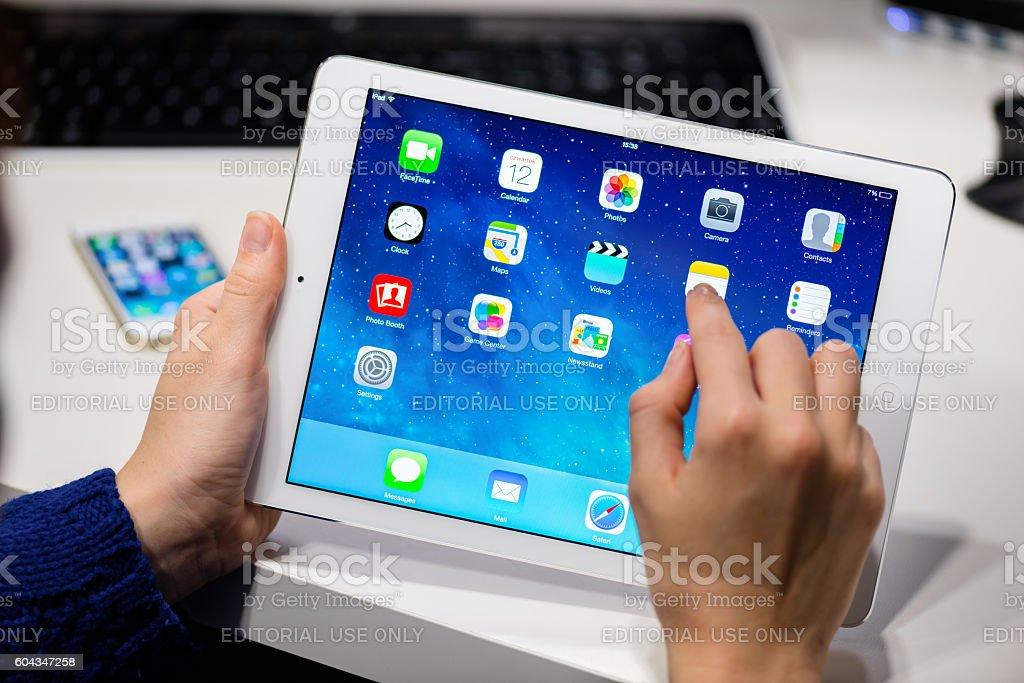 Holding white iPad Air stock photo