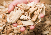 A pile of wood chips isolated on white background