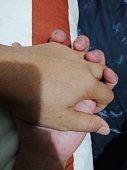 istock holding-hands 1281929233