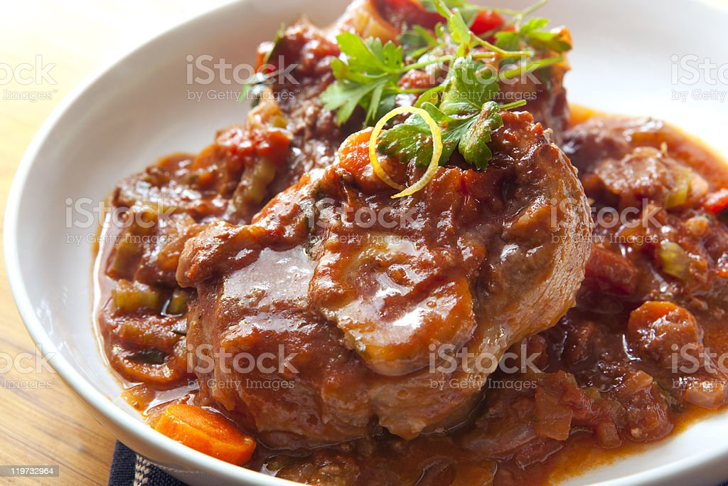 Osso Buco Classic osso buco.  Veal shanks slow cooked with tomatoes, carrots and onion.  Hearty, warming food.  More beef images: Animal Bone Stock Photo
