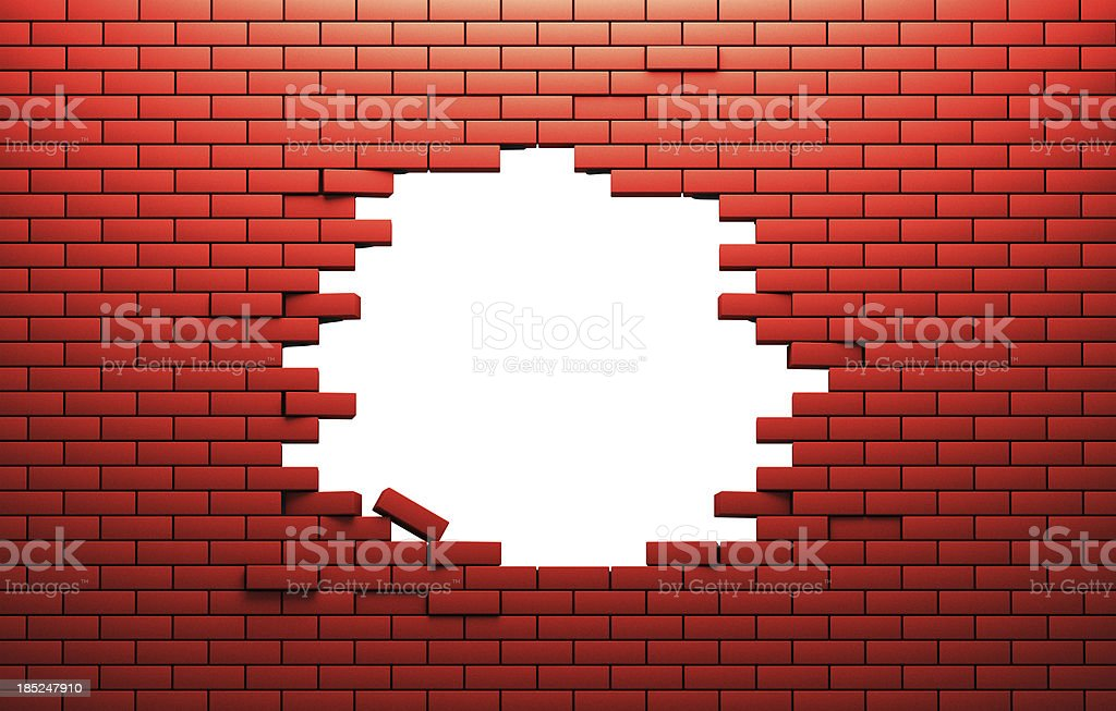 Hole in a brik wall stock photo