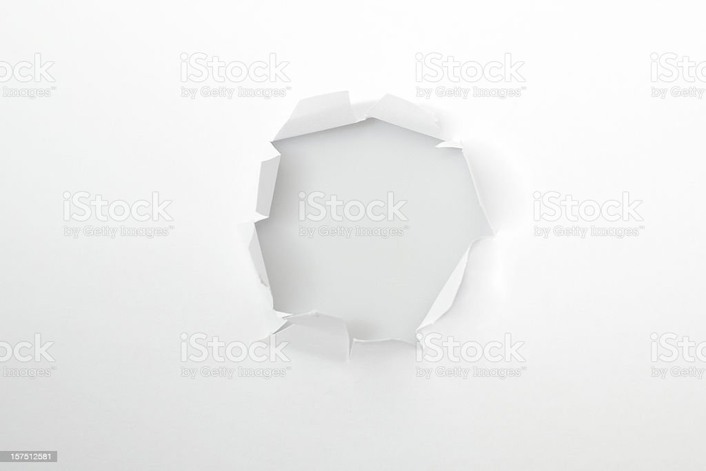 Hole in a white paper royalty-free stock photo