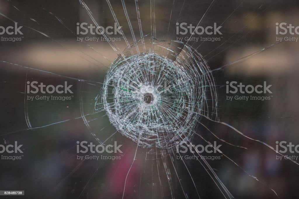 hole in a window stock photo