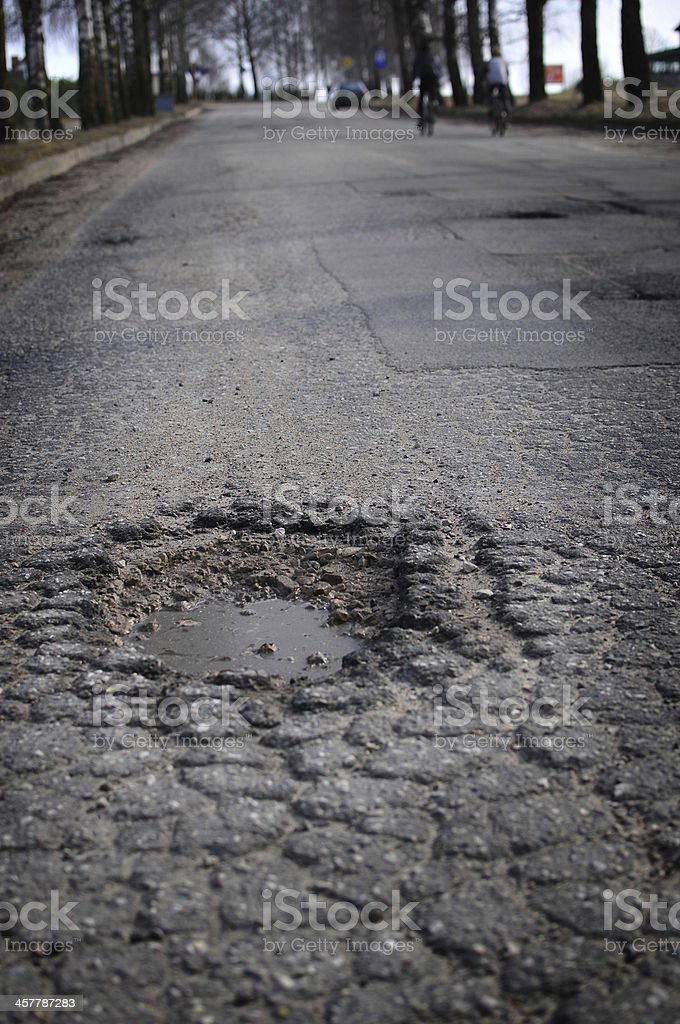 Hole in asphalt stock photo