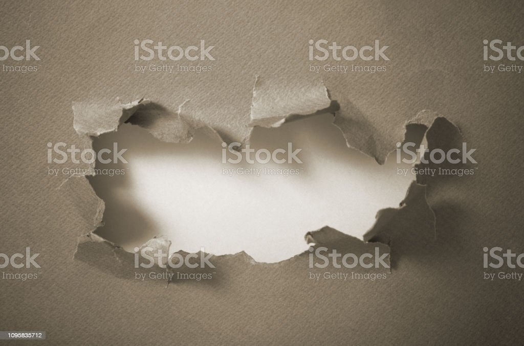 Hole in blue paper, abstract background stock photo