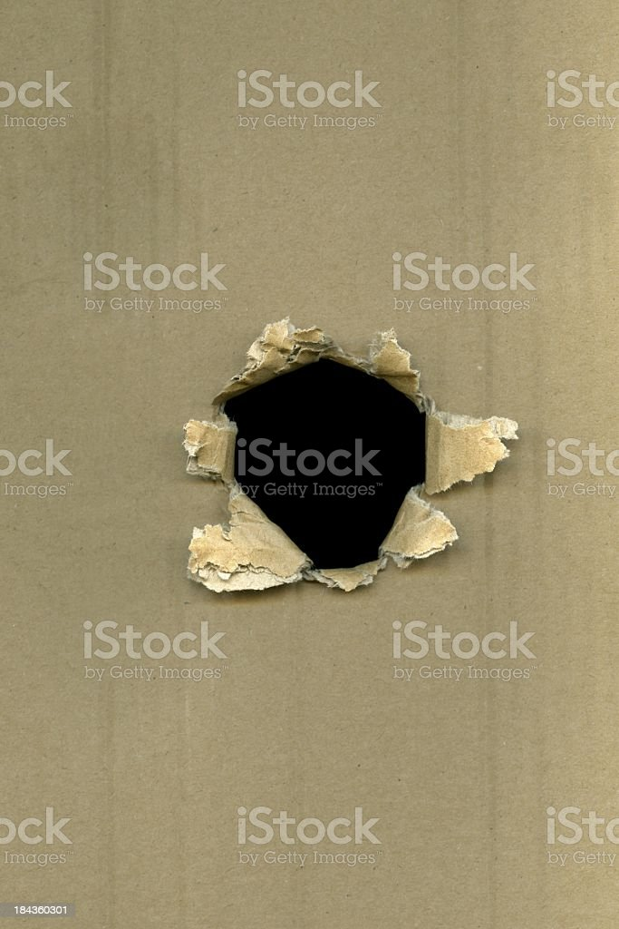 hole in cardboard royalty-free stock photo