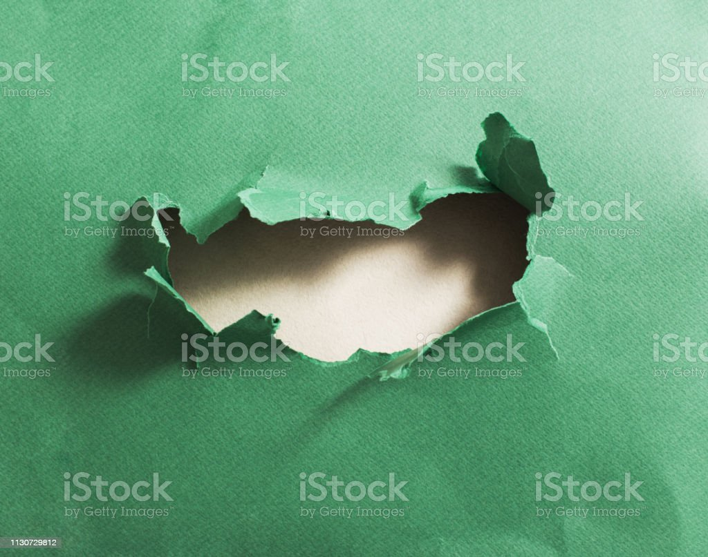 Hole in green paper, abstract background stock photo