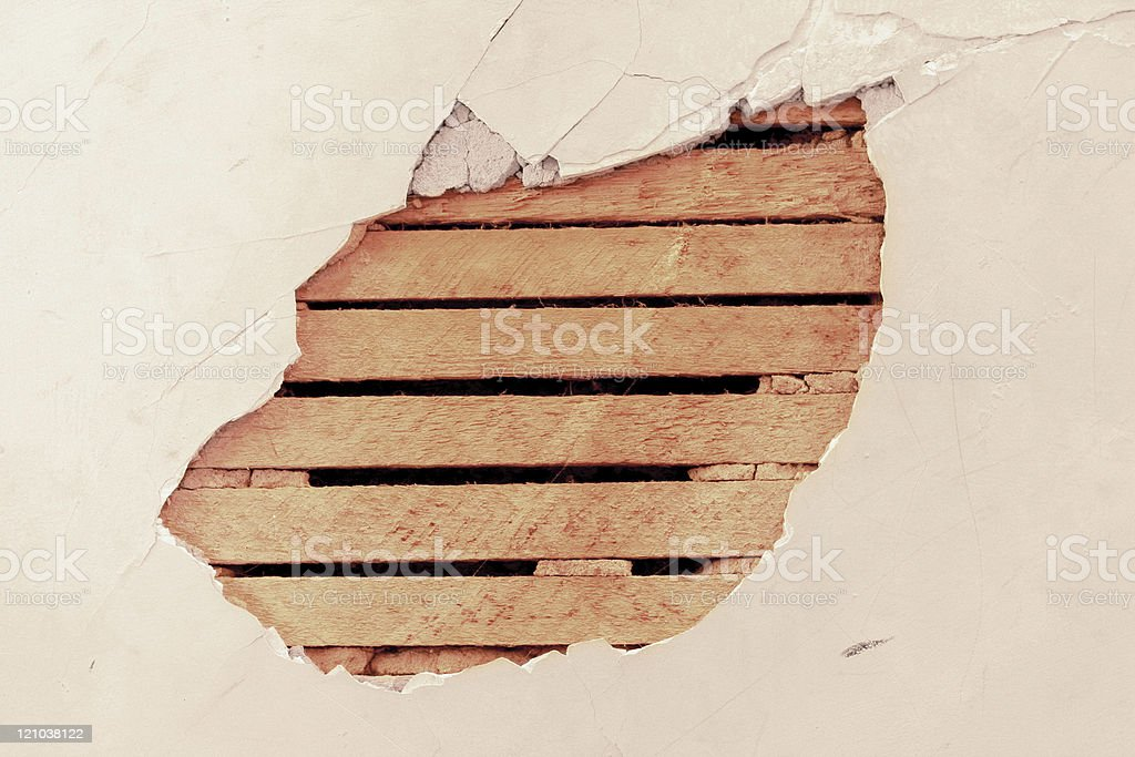 Hole in Plaster Wall - Wood Lath stock photo