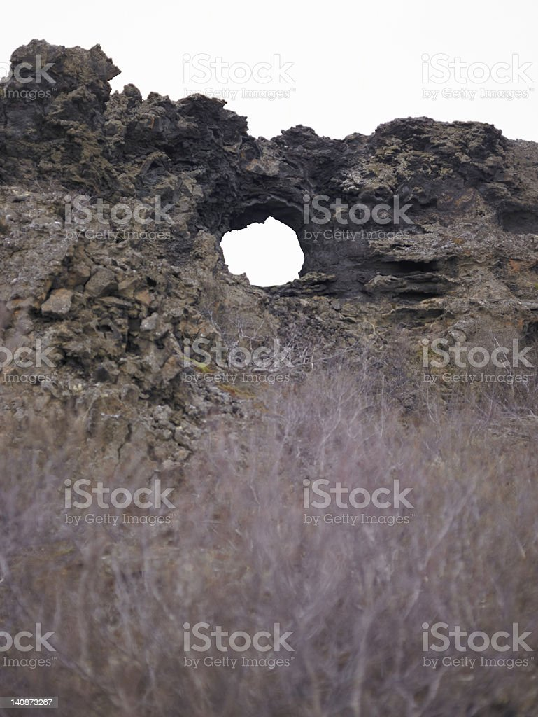 Hole in rural rock formation stock photo