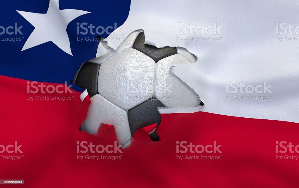 Buraco na bandeira do Chile e bola de futebol - foto de acervo