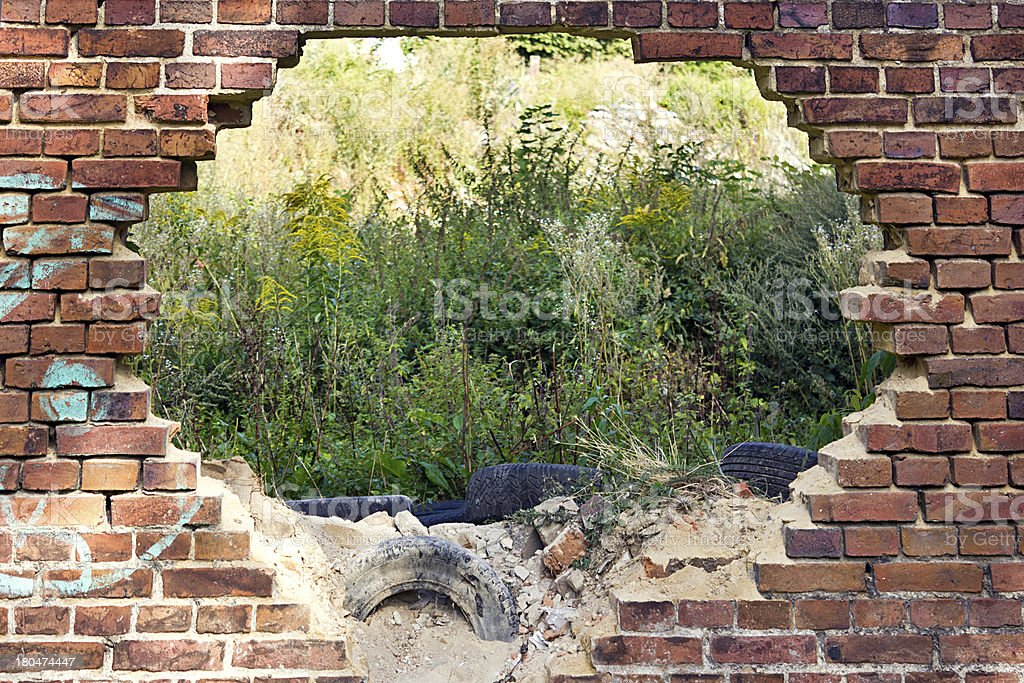 Hole in the old brick wall stock photo