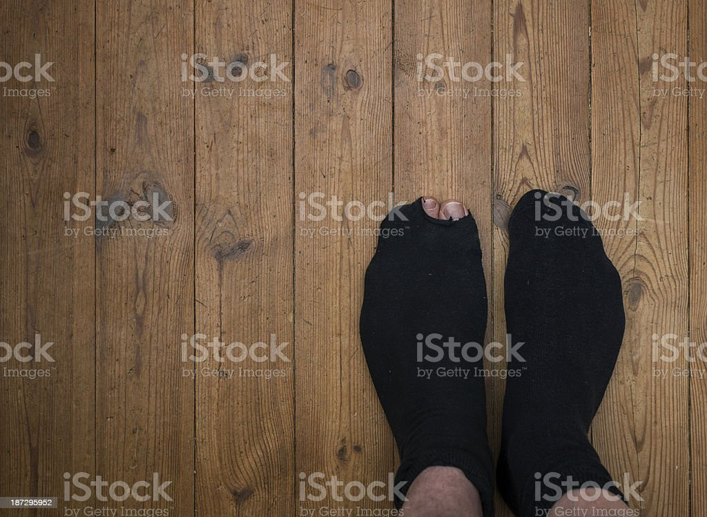 hole in the sock stock photo