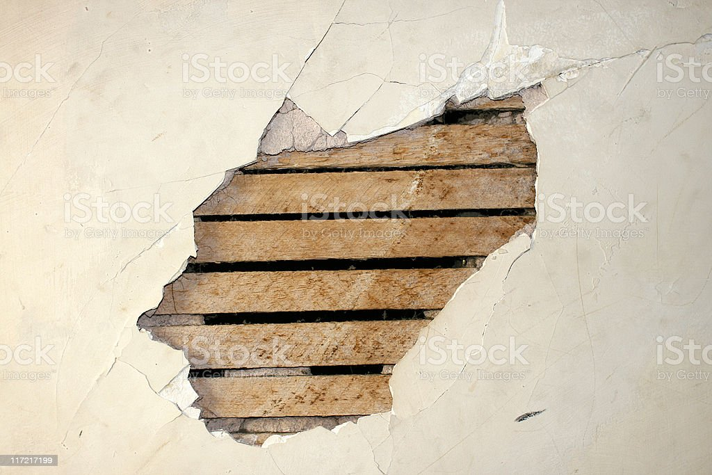Hole in the Wall - Cracked Plaster stock photo