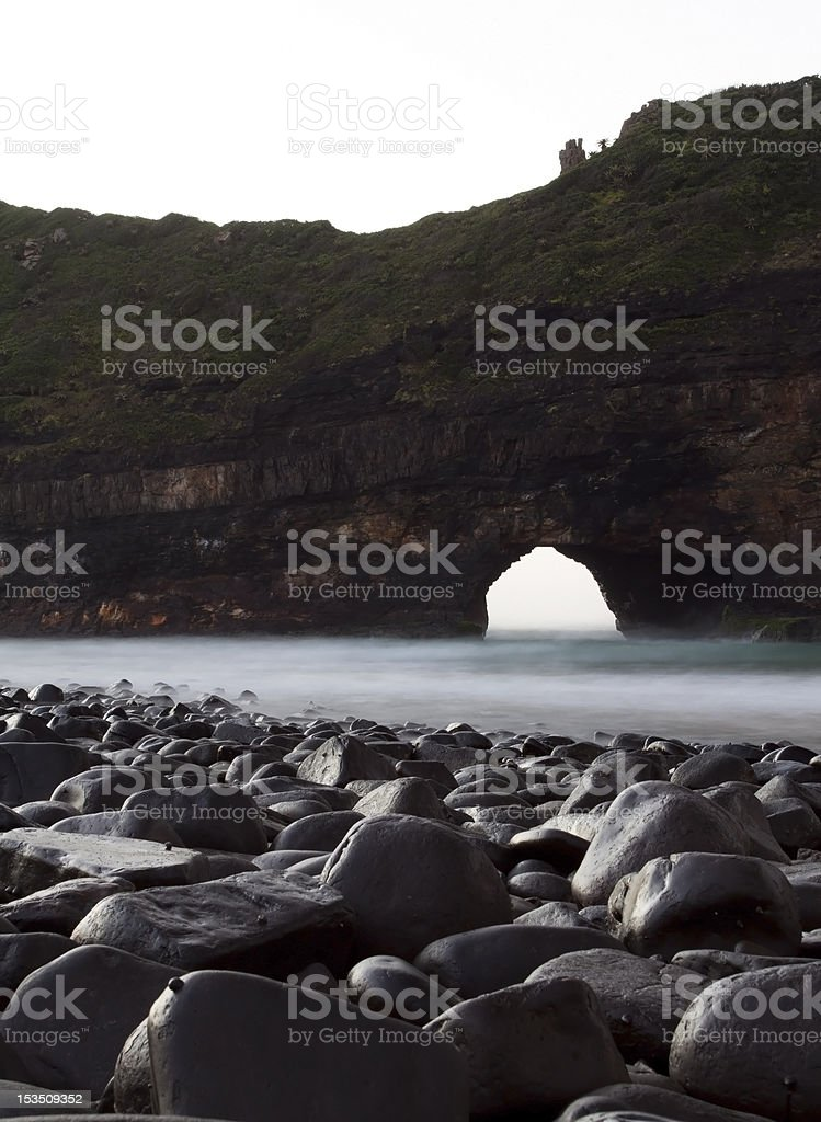 Hole in the wall landscape wet rocks stock photo