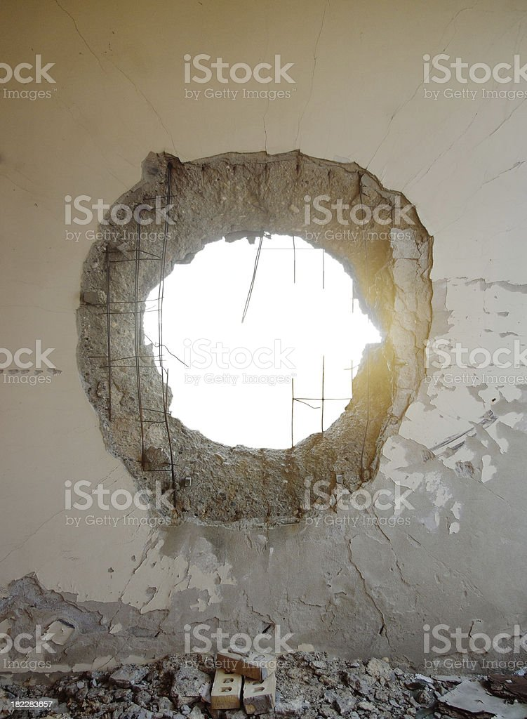 Hole in the concrete wall from tank shell with isolated space