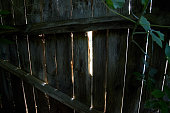 istock A hole in the wooden fence in the backyard of the garden 1164694439