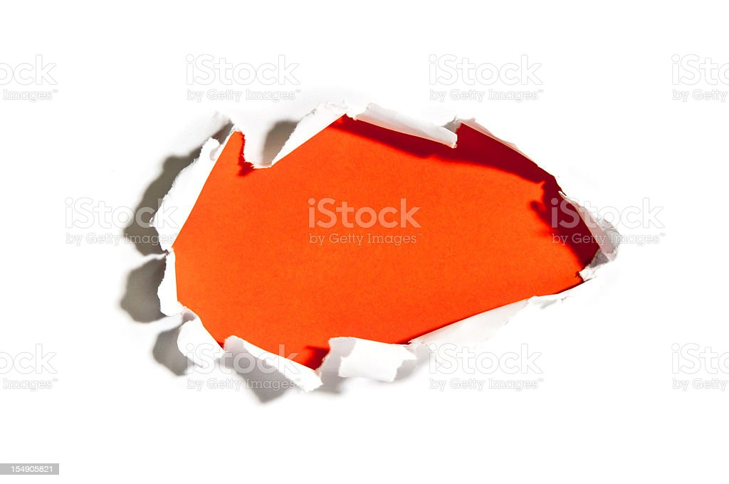 hole in torn paper stock photo