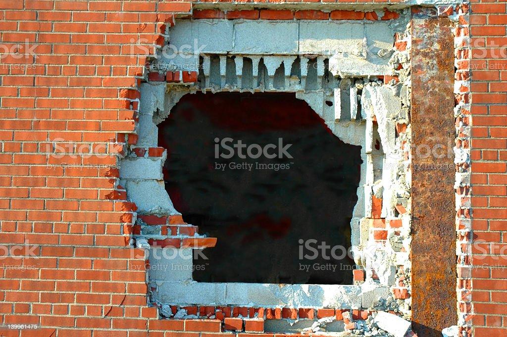Hole in brick wall