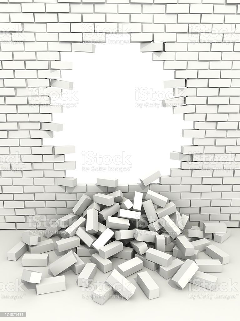 hole in white brick wall stock photo