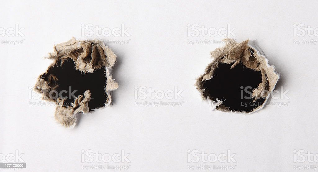 hole in white paper stock photo