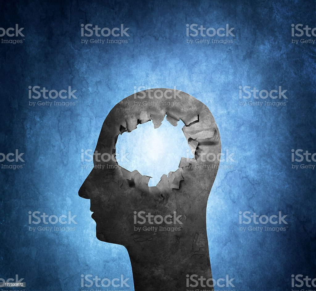 Hole mashed through head in a painting stock photo