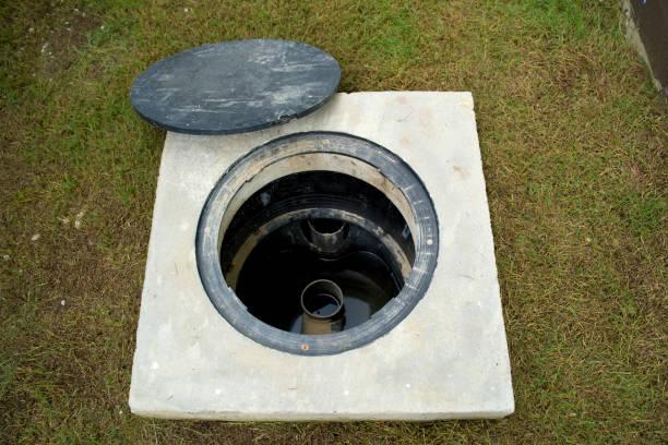a hole of grease trap with the drain system around the house. - trappola foto e immagini stock