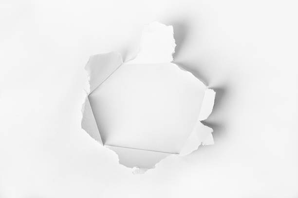 Hole punched in the paper stock photo
