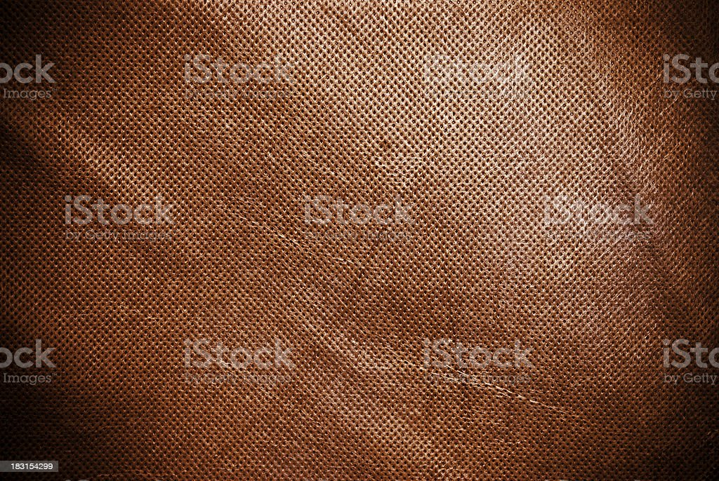 Holed and creased brown canvas background or texture royalty-free stock photo