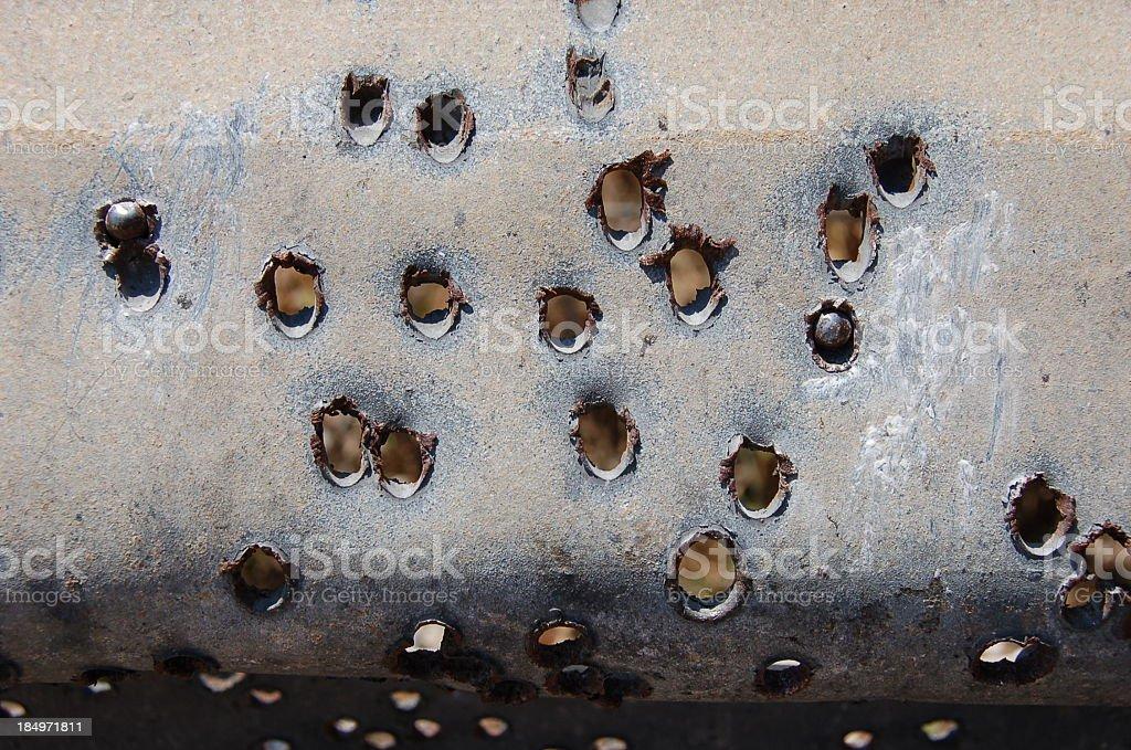 Holes bored through metal sheet stock photo