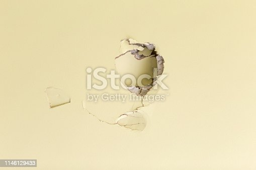 Hole in a sheetrocked - drywall - wall. Vandalism.