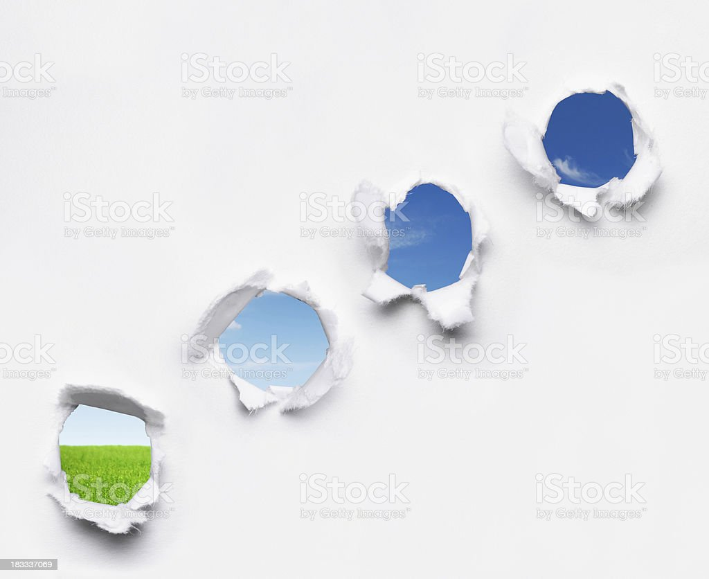 Holes in Paper royalty-free stock photo