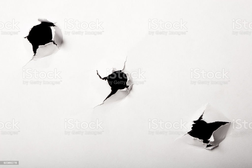 Holes on a white paper royalty-free stock photo