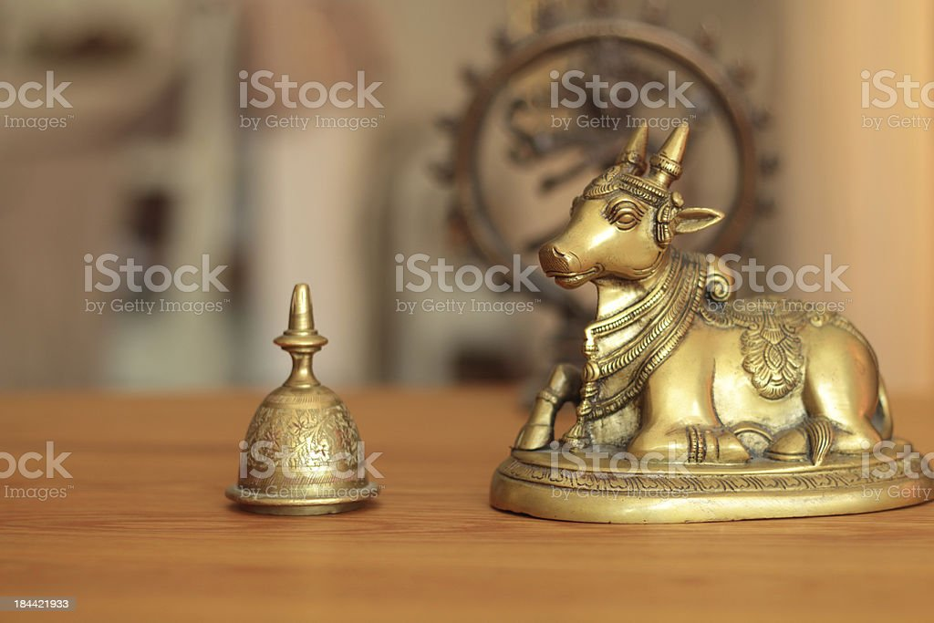 holey cow in a golden shimmer with The God Shiva stock photo