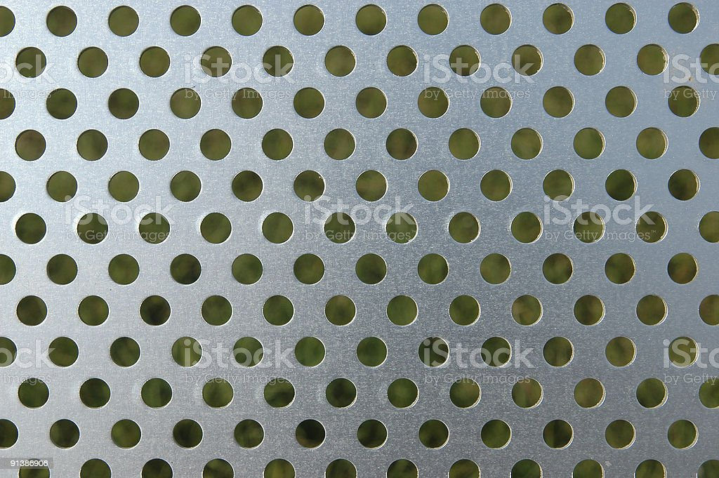 holey metal surface royalty-free stock photo