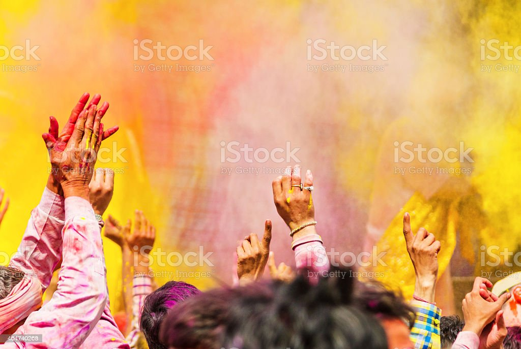 Holi festival hands with coloured powder, India stock photo