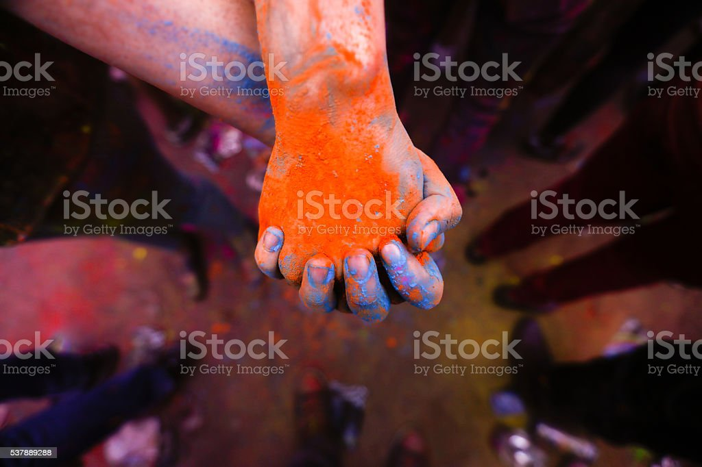 Holi festival hands with coloured powder stock photo