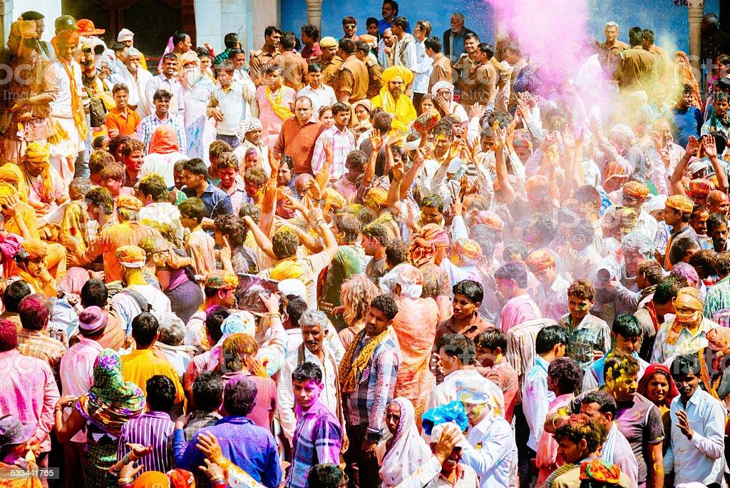 Holi Festival India Crowd Celebrating Large crowd of paint covered individuals enjoying the Holi Festival, Barsana, Rajasthan, India. 2015 Stock Photo