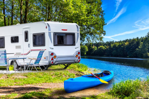 holiday at krutynia river in masuria land, poland - motorhome stock photos and pictures