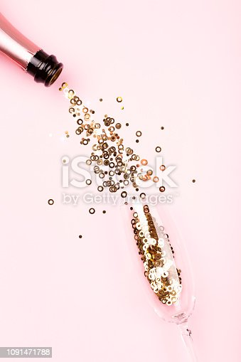 istock Holiday background with confetti and champagne. 1091471788